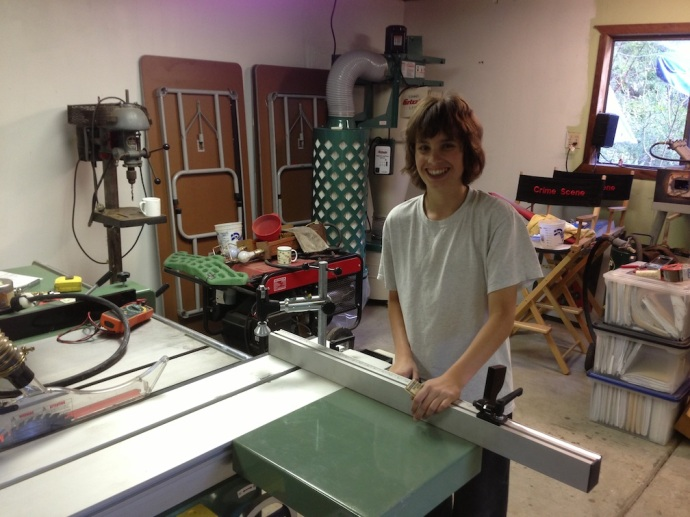 Kolya waiting to make a test cut on the table saw