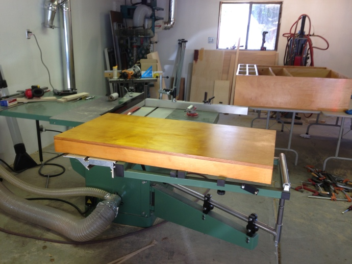 One door with a coat of shellac, the main body of the cabinet is in the background