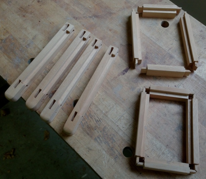 Rails and stiles for one sconce body - the clearances between the mortises and glass channels were too close for comfort and necessitated severely offset tenons.