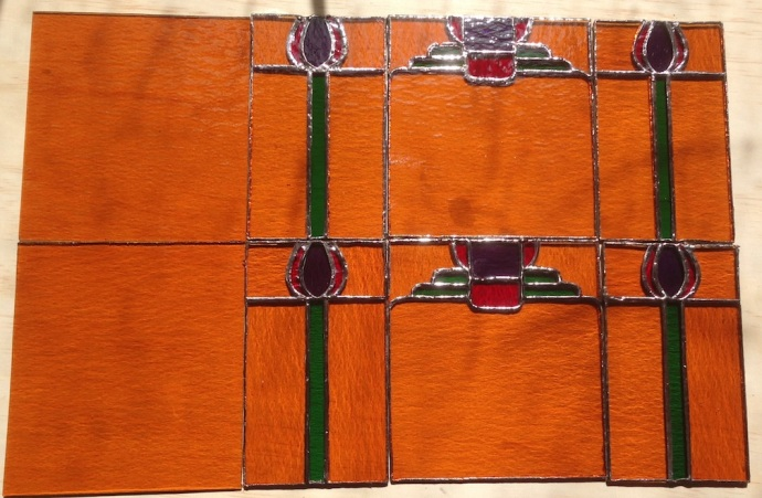 Stained glass panels for the sconces