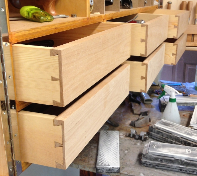 Drawers prior to installing the pulls and finishing