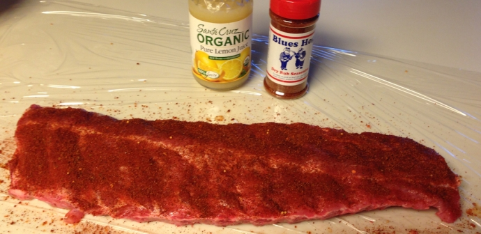 Ribs prepared, rub with lemon juice and coated with dry rub