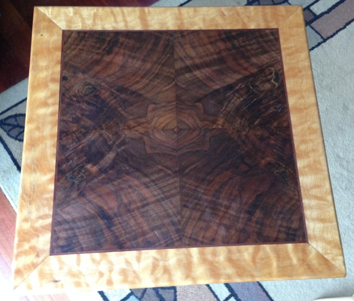 Table top, four-way book match claro walnut, bloodwood stringing and quilted maple edging