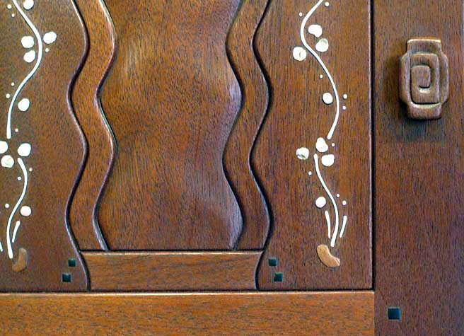 Carved knob on a reproduction of the Blacker House sideboard