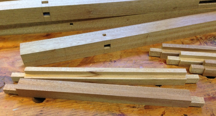 Tenons on the stretchers, the recess for the lower shelf is also done.