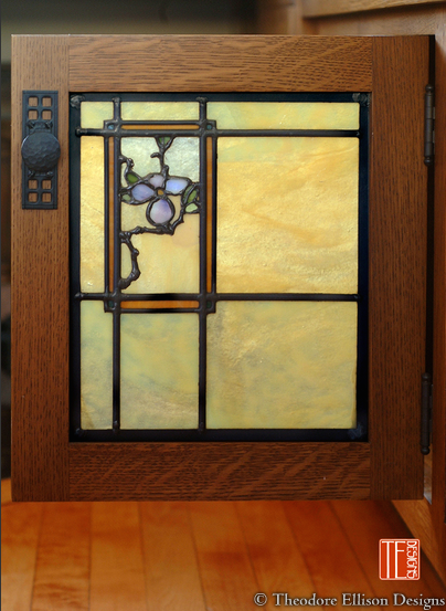 Detail of a cabinet door designed to match nearby windows