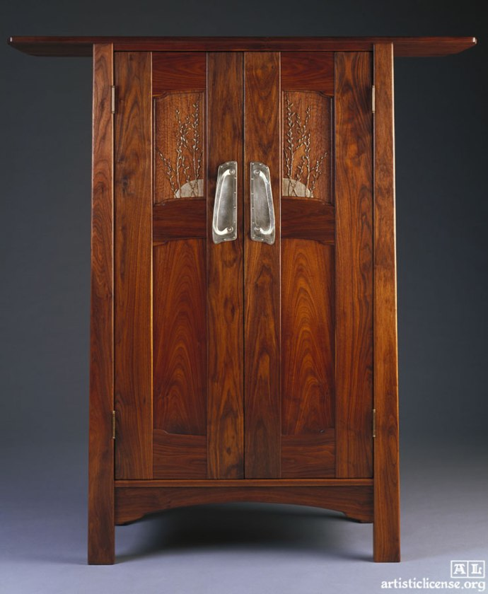 "Aesthetic Cabinet. 70""H, 60""W, 23""D. Black walnut. We have made this piece several times. One is in the Greene and Greene Blacker House with water lilies carved on it. Photo: David Ramsey."