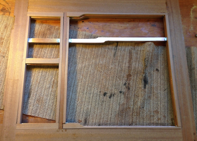 Back of the door showing the wood strips to hold the glass in, cut to length, shaped and sanded.