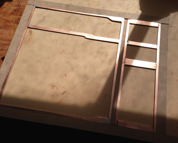 "Wood base set up, 3/4"" MDF, and 1/8"" hardboard strips to hold the copper frames in position"