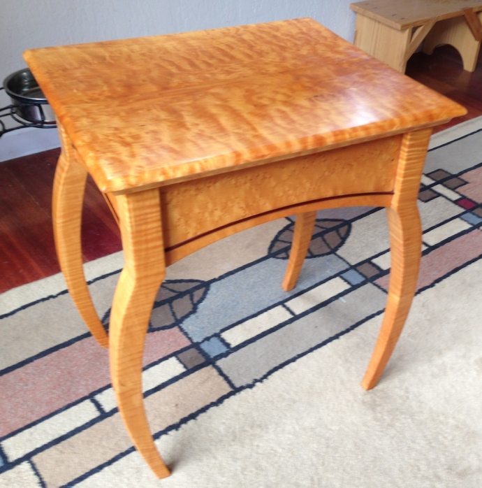 Refinished spider table, showing a weird mix of Quilted Western Maple, Birdseye Maple and Tiger Maple, with bloodwood cock beading