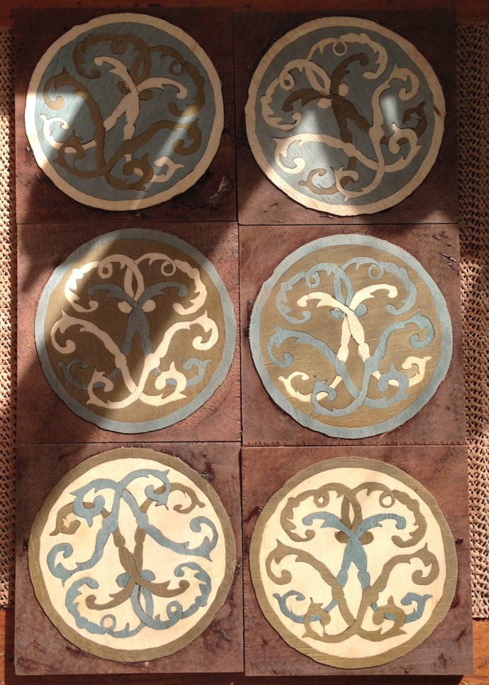 Coasters glued to the bases and scraped clean