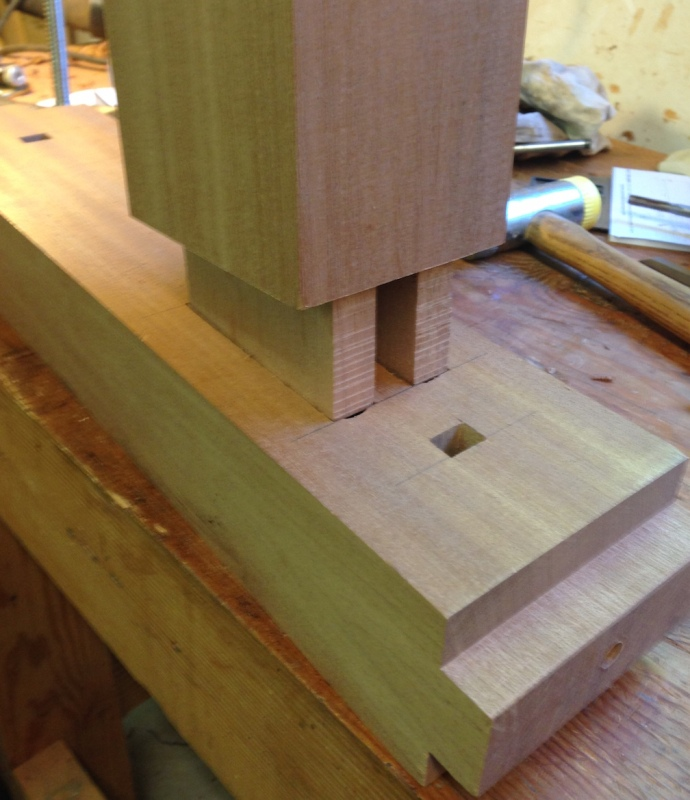 Double tenon on the top of the vertical post.  The faces and shoulders were cut with a dado stack (the part horizontal on the table saw).  The faces between the tenons cut on the bandsaw, and the waste chiseled out.