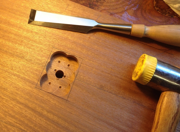 "This is the blind mortise for the toggle arm that actuates the clamp.  The clamp assembly is bolted from below.  I used a 1"" bit to clear most of the material, being careful to hit the same depth each time."