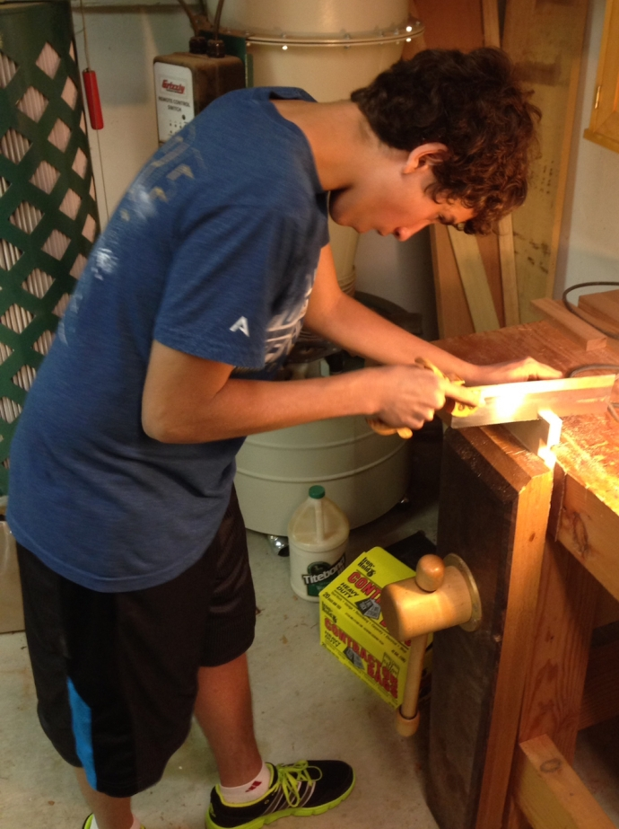 Kolya sawing his first set of dovetails