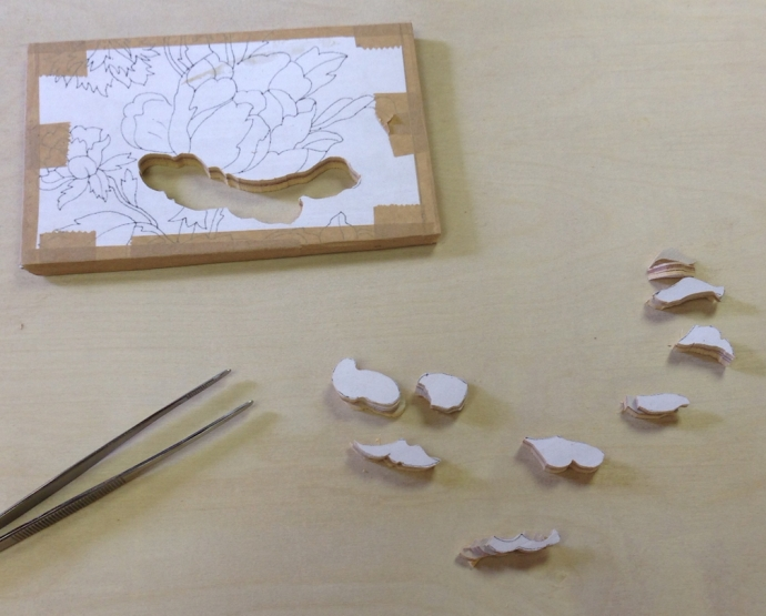"I also practiced laying out the parts in an ""exploded diagram"" of the image as I sawed them out.  I had these first pieces sawn out before I thought to take a picture!"
