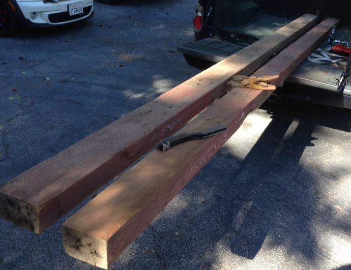 "Two 4"" x 6"" beams from an old barn.  I think I paid extra for the peeling paint and nails."