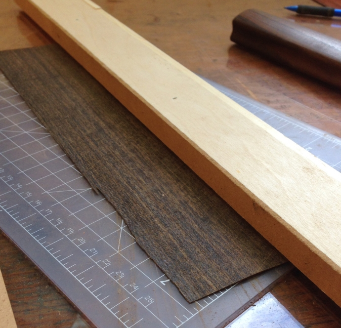 Slide the veneer under the tool's spacer, then put the straightedge against the tool, and remove the filletti tool.