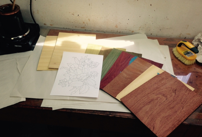 "Here are the raw materials for the next marquetry project.  Backer (and ""fronter"") sheets, veneer for all the colors in the picture plus the background, and a reversed copy of the design."