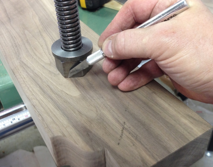 Transferring the outline of the nut to the inside face of the vise.