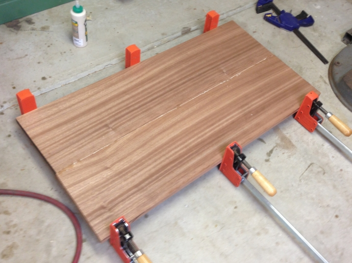 "Glue up for the top.  The finished size will be a tick over 22"" wide by about 36"" long with the breadboard ends installed.  This is slightly overlong still, and I'll hand plane it to level the glue line."