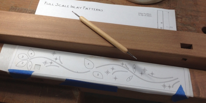 I started by indexing the pattern to the part using the ebony plug location, then I added a sheet of Saral transfer Paper in between and traced the pattern with a ball stylus