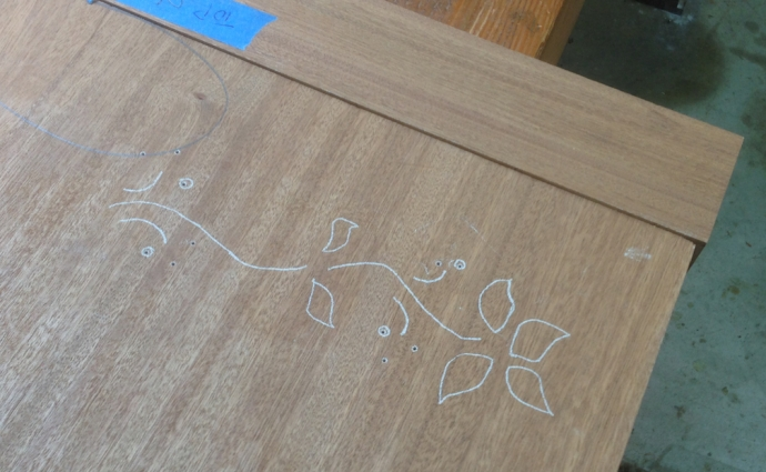 The traced pattern is accurate enough to freehand route the vines, but not to route out the cavities for the petals.