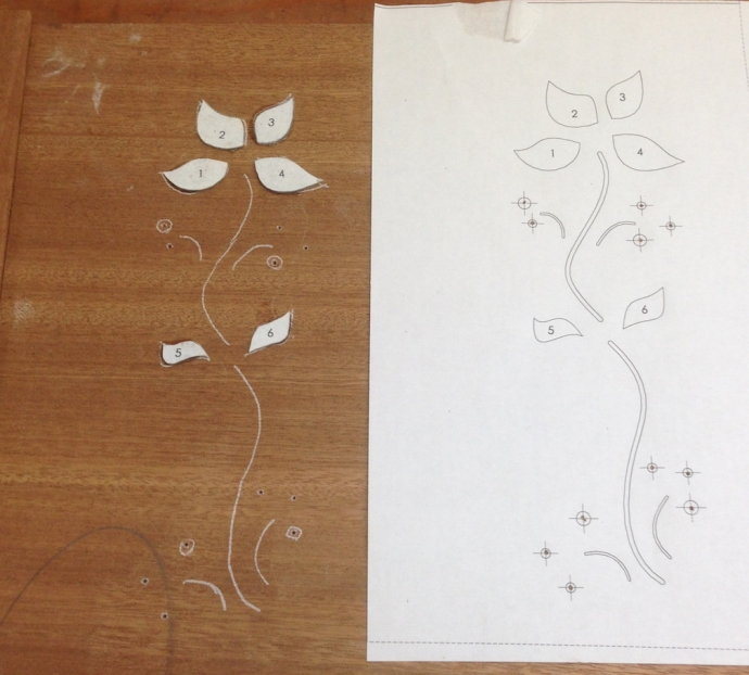 To layout the petals, I duco-glue the shell cut outs in place, using the tracing as a rough positioning guide.  Then I trace around each piece of shell using a scalpel.  The incised line gives me an accurate line to route up to.