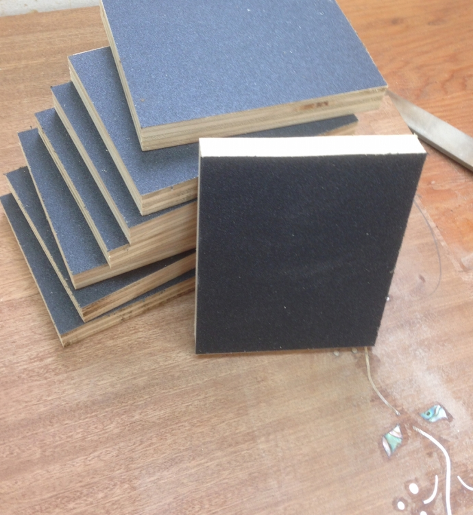 I made up these sanding blocks using scrap plywood and 120 grit sandpaper.  It takes some elbow grease to get the last bit of glue cleaned up.